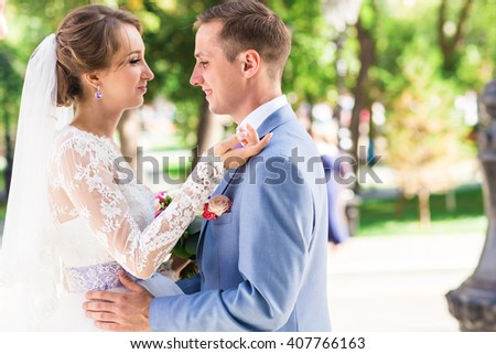 Bride and groom on a romantic moment outdoors