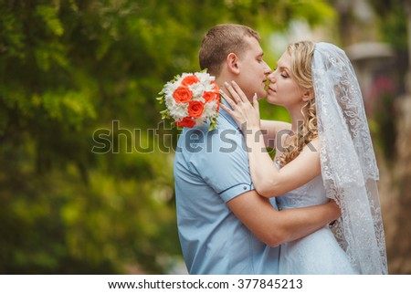 Bride and groom wedding portrait outdoors newlyweds loving couple kissing marriage bridal flowers, kissing man and woman at wedding day, selective focus, series