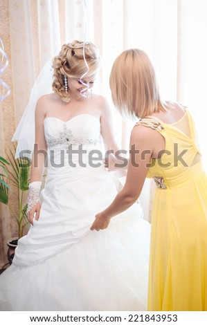 stock photo bride getting ready beautiful bride in white wedding dress with hairstyle and bright makeup happy 221843953