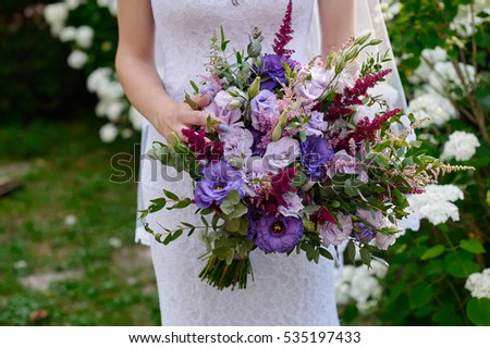 bride holding a beautiful bridal bouquet