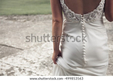 Bride in beautiful white wedding dress. Detail