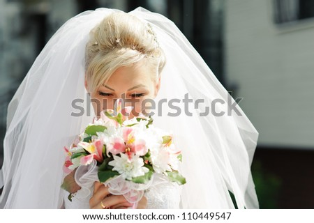 Bride in wedding dress. Bridal wedding bouquet of flowers