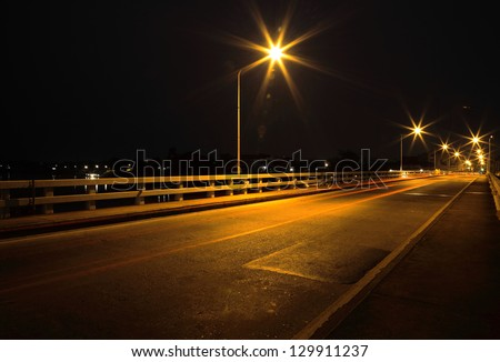 Bridge across the river at night in Ubon Ratchathani, Thailand.(Mun River)