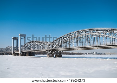 Bridge across the river Neva, Russia, St. Petersburg. Blue sky and winter time