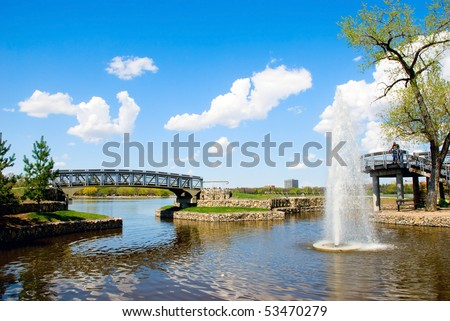 Bridges, little fountain and blue sky with clouds