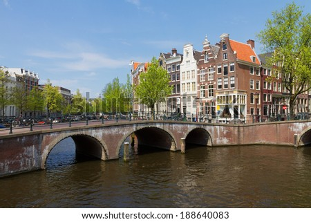 bridges of canal ring at sunny summer day, Amsterdam, Netherlands