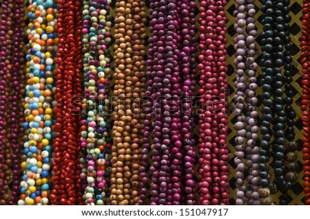 Bright background of handmade strands of colorful beads