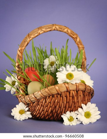 eggs on blue bright easter eggs on blue basket with flowers on blue ...