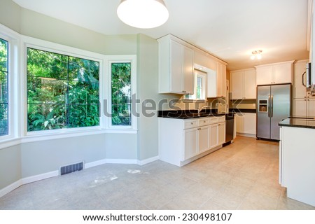 Bright empty dining room interior with tile floor and round corner