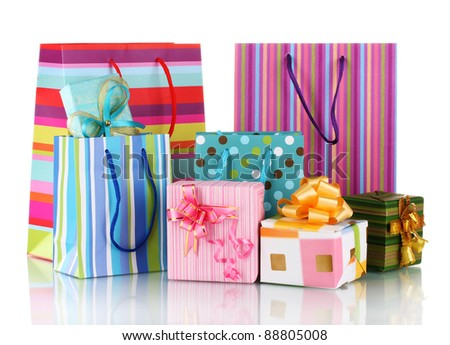bright gift bags and gifts isolated on white