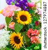 Bright multicolor bouquet made of different flowers - stock photo