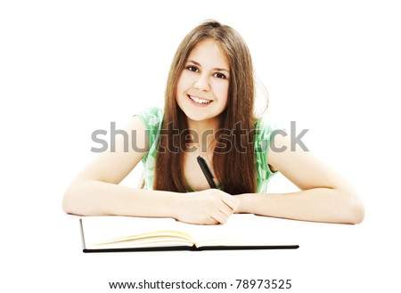 Bright picture of a beautiful school girl at her desk