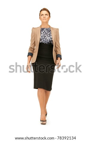 bright picture of calm and serious walking woman