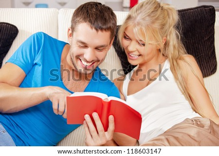 bright picture of happy couple with book (focus on man)