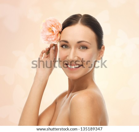 bright picture of smiling woman with flower