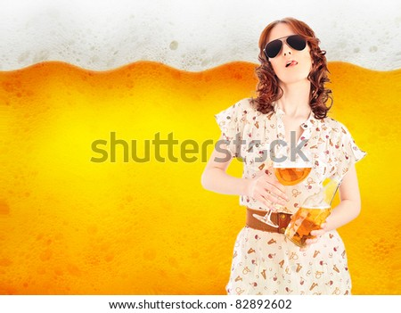 Bright poster of hot sexy woman holding glass and bottle full of beer licks her lips. Close up of beer bubbles on the background. Advertisement banner with copyspace