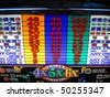bright slot machine symbols are what you want to come up - stock photo