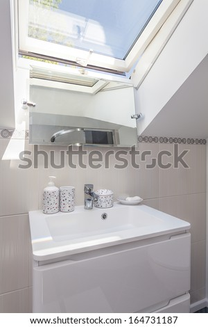 Bright space - a white sink and a mirror