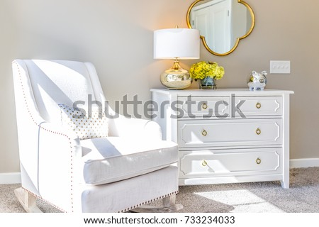 Bright White Modern Rocking Chair In Nursery Room With Chest Of Drawers,  Decorations In Model