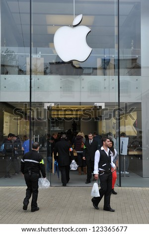 BRISTOL- SEPT 21: Shoppers enter an Apple store as the Iphone 5 is launched in the UK and Europe on Sept 21, 2012 in Bristol, UK.