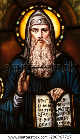 BRISTOW, VIRGINA - APRIL 26, 2015: Stained glass window depicting St. Benedict of Nursia holding the Rule of Benedict, located in chapel of St. Benedict Monastery