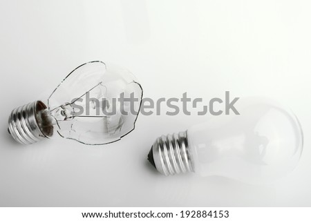 broken electric bulb and new bulb