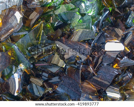 Broken Glass Bottle Pieces on a Cement Floor
