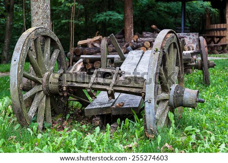 Broken vintage wooden cart in the countryside