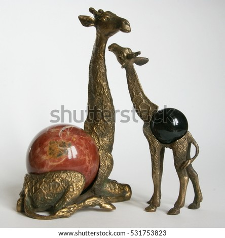 Bronze giraffe with jasper ball