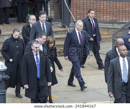 Brooklyn, NY - January 04, 2015: FBI Director James Comey, US Senator Chuck Schumer, Rikky Klieman attend ceremony at Aievoli Funeral Home for the funeral of slain NYC Police Officer Wenjian Liu