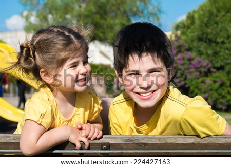 Brother and sister have a nice day at the park