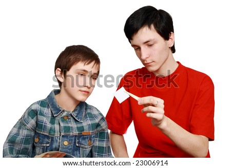 Brothers examine a stamp