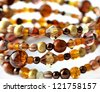 Brown bracelet on white - stock photo