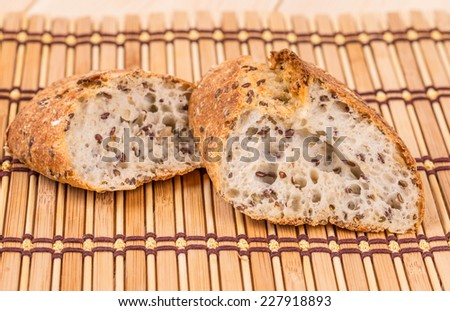 Brown bread with seeds on a table. Whole background.