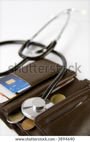 Brown card holder with a stethoscope checking it on a white background.