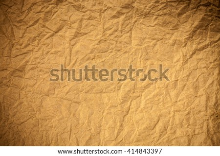 Brown crumpled eco paper background.