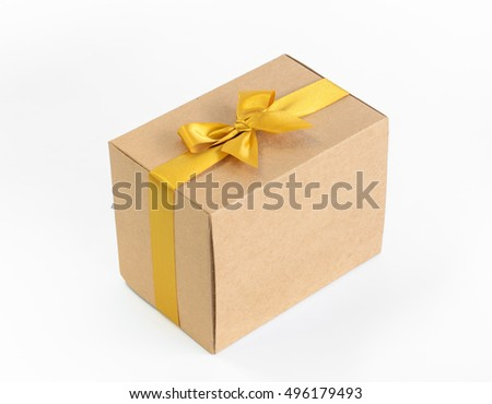 Brown gift box with gold bow on white background