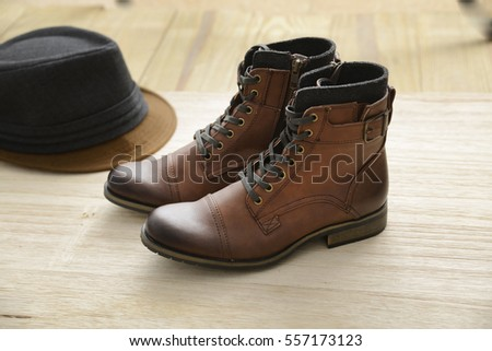 brown leather boots shoes with hat -wooden board