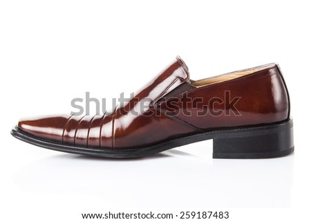 Brown leather fashion shoes isolated on white