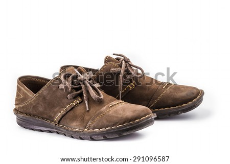 Brown leather shoes on white background