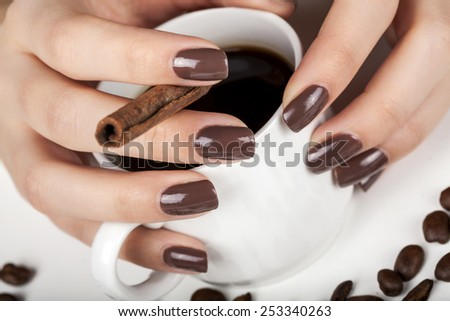 Brown manicure and cinnamon.