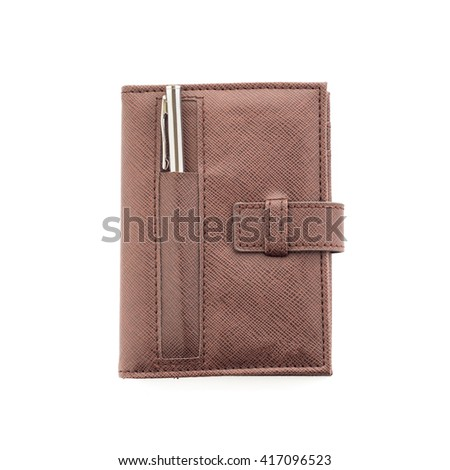 Brown notebook and pen isolated on white background