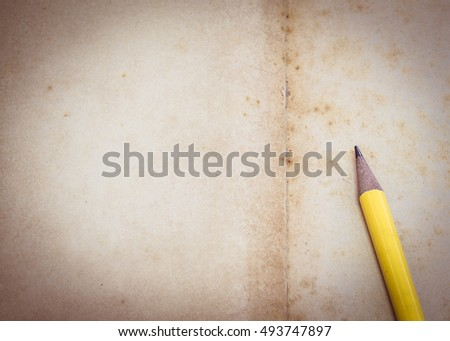Brown old paper,  blank page  with yellow pencil can be used for your  text or copy space