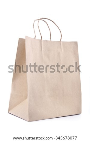 Brown paper bag on white background