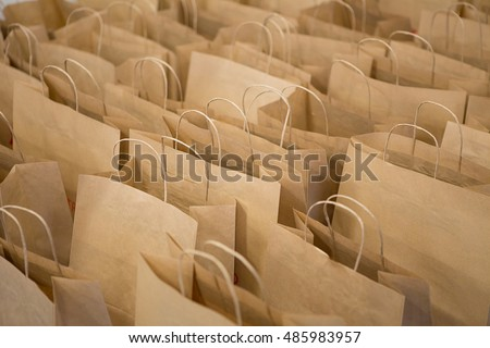 Brown paper bags in rows