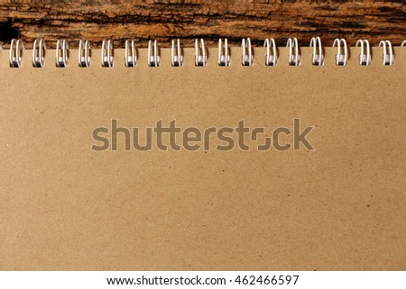 brown paper notebook with empty for text