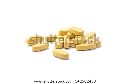 brown pills on white background