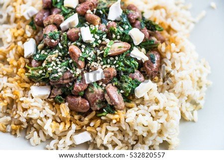 Brown Rice with Kidney Beans, Spinach, Goat Cheese and Sesame, Healthy Detox Vegetarian Lunch. Top View, Clean Food