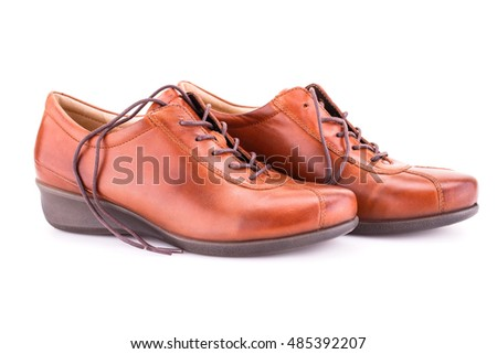 Brown shoes isolated on white background.