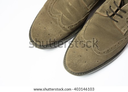 brown used budapester suede shoes on white background